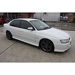 2/2006 Holden Commodore SV6 VZ MY06 4d Sedan White 3.6L
