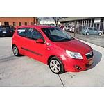 9/2009 Holden Barina TK MY09 3d Hatchback Red 1.6L